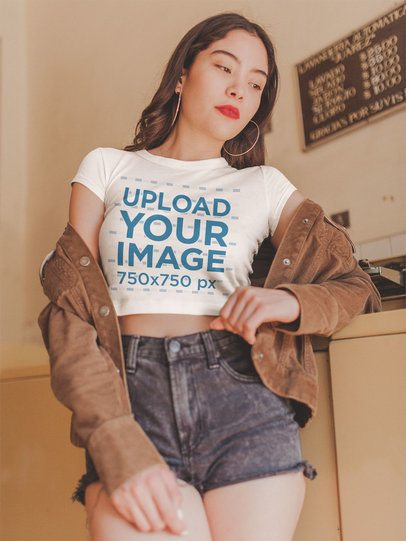 Asian Girl Wearing a Crop Top Tee Mockup at the Laundry a19318