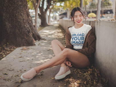 Smiling Asian Woman Wearing a Crop Top Tee Mockup at a Park a19317