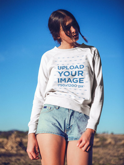 Portrait of a Woman Wearing a Crewneck Sweater Mockup Outdoors a18921