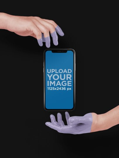 iPhone X Template Floating Between Two Painted Hands a19310