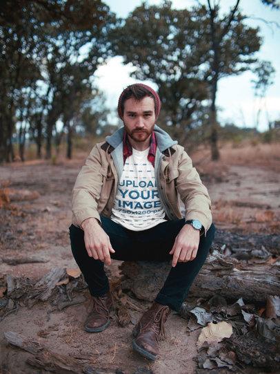 Man Crouching Wearing a Tshirt Mockup Outdoors a19031