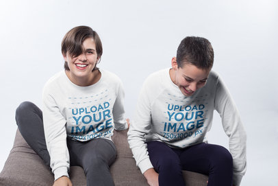 Lesbian Sweatshirt Mockup of a Happy Couple Wearing Crewneck Sweaters in a White Room a19980