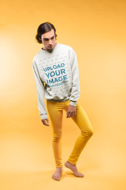 Barefoot Man Wearing a Crewneck Sweatshirt Mockup and Yellow Pants at a Studio a19676