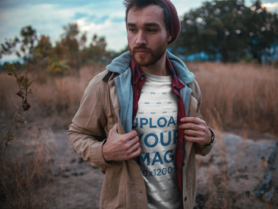 Sad Man Walking Outdoors Wearing a T-Shirt Mockup a19029
