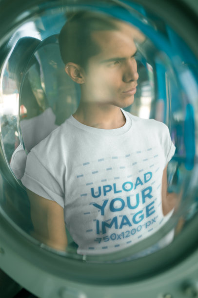 Through a Glass Mockup of a Man Wearing a T-Shirt at a Laundry a19700