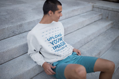 Man Sitting on Concrete Stairs Wearing a Sweater Mockup a19709