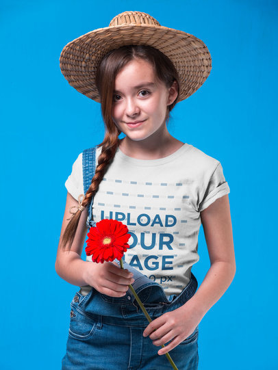 Country Girl Wearing a T-Shirt Mockup Holding a Red Sunflower a19581