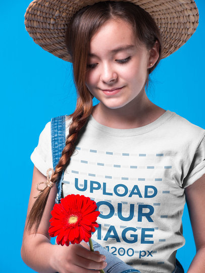 Girl Holding a Red Sunflower Wearing a T-Shirt Mockup a19582