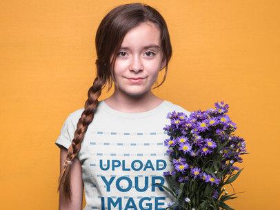 Girl Wearing a T-Shirt Mockup Against an Orange Wall a19590