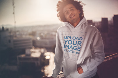 Mockup of a Dude with an Afro Wearing a Pullover Hoodie During the Sunset a18948