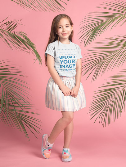 Pretty Little Girl Wearing a T-Shirt Mockup Standing Near Plants a19729
