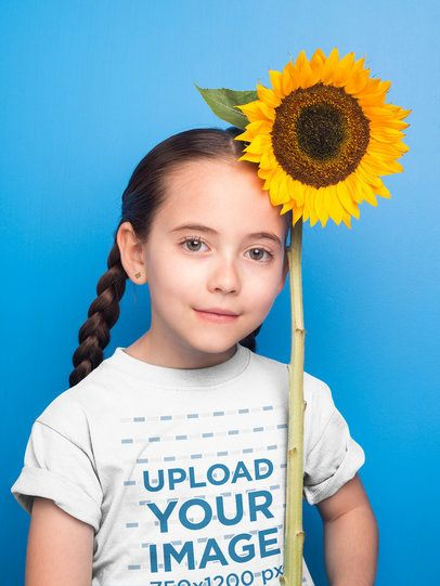 Pretty Little Girl with Braids Wearing a Tshirt Mockup Holding a Sunflower a19733