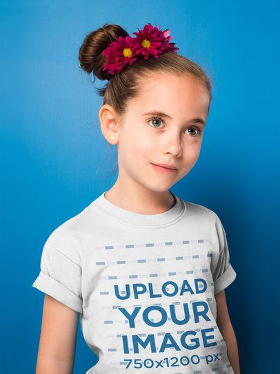 Portrait of a Beautiful Girl Wearing a T-Shirt Mockup Against a Blue Wall a19736