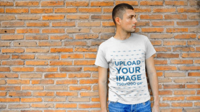 Young Man Wearing a T-Shirt Video Leaning Against a Brick Wall a12228
