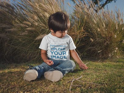 Little Kid Wearing a T-Shirt Mockup at a Park a20192