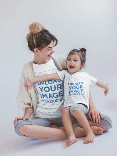Girl and Mom Having Fun Wearing T-Shirts Mockup in a White Room a20274