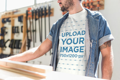 Cropped Face Carpenter Wearing a T-Shirt Mockup While at his Workshop a20163