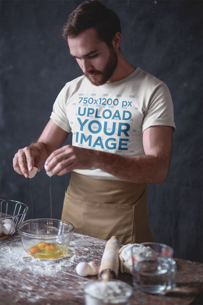 Baker Wearing a Tshirt Mockup Breaking Eggs a20269