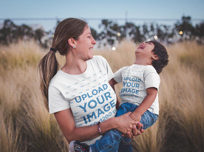 Mom and Son Wearing T-Shirts Mockup Outdoors while Having Fun a20203