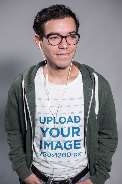 Smiling Nerd Dude Wearing a T-Shirt Mockup Listening to Music a19359