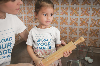 Girl Learning how to Cook Wearing a T-Shirt Mockup with her Mom a20279