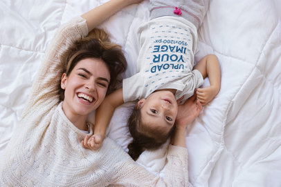 Happy Girl Wearing a T-Shirt Mockup with her Mom on Bed a20286