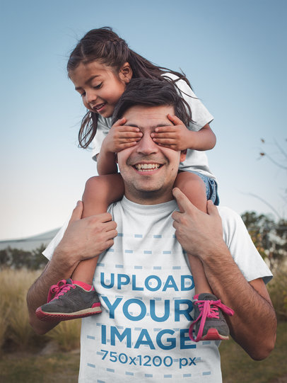 Happy Dad Wearing a T-Shirt Mockup Playing with his Daughter a20202