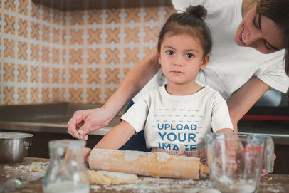 Girl Learning how to Bake Wearing a T-Shirt Mockup with her Mom a20281
