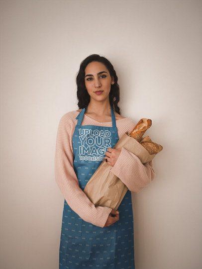 Baker Wearing an Apron Mockup Holding Bread a19808