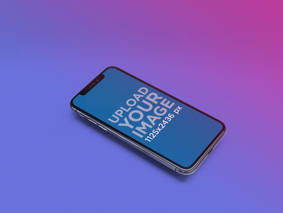 iPhone X Mockup Lying on a Bicolor Gradient Surface a20118