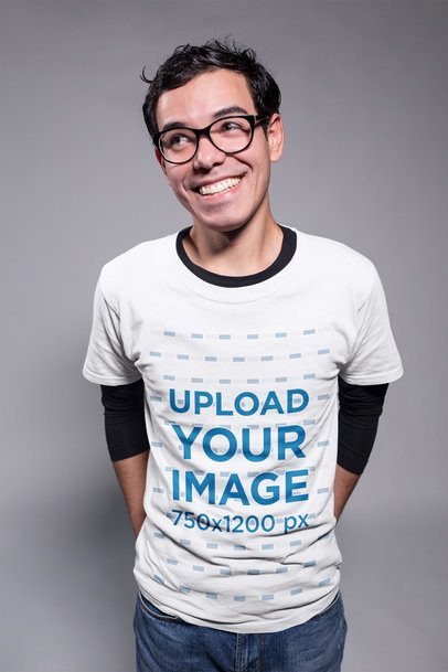 Smiling Nerd Guy Wearing a Tshirt Mockup in a Gray Room a19365