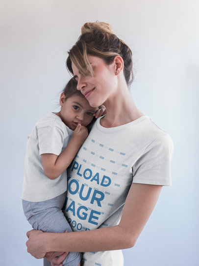 Mom Wearing a T-Shirt Mockup Lifting her Daughter a20273