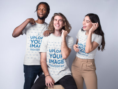 Interracial Group Featuring a Black Dude with a White Guy and an Asian Girl Wearing T-Shirts Mockup a19952