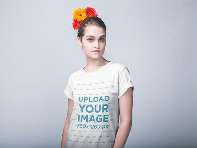 Woman with Flowers on her Head Wearing a T-Shirt Mockup Against a White Wall a19949