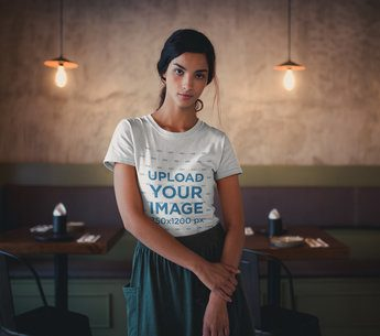 Front Shot of a Beautiful Girl Wearing a T-Shirt Mockup at a Restaurant a20108