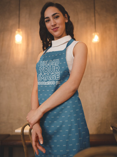 Smiling Hispanic Woman Wearing an Apron Mockup While Working a19818