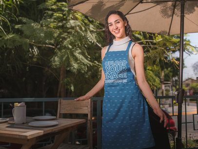 Happy Girl Wearing an Apron Mockup on a Terrace During a Sunny Day a19823