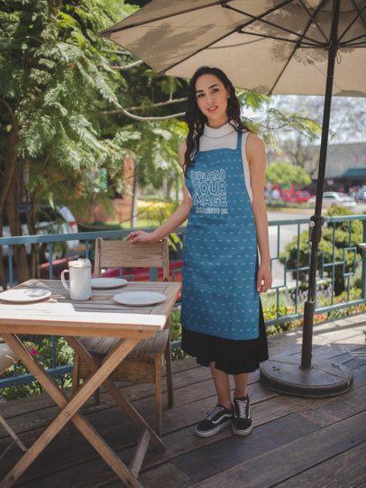 Waitress Wearing an Apron Mockup on a Terrace a19822