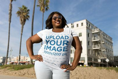 Happy Black Woman Wearing a Plus Size T-Shirt Mockup Near Palms a18220