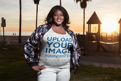 Smiling Woman Wearing a Plus Size Tee Mockup at the Beach a18226