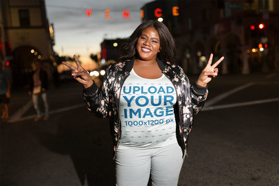 Black Girl Wearing a Plus Size Tshirt Mockup Near a Venice Sign a18305