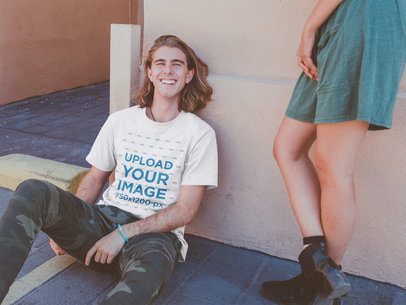 Happy Blonde Dude Wearing a T-Shirt Mockup on the Street a20100