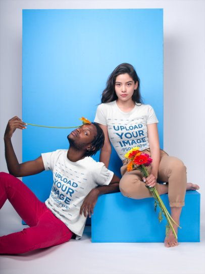 Interracial Couple Featuring a Black Dude and White Girl Wearing T-Shirts Mockup Holding Flowers a19920