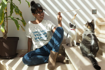 Woman Playing with her Cats Wearing a T-Shirt Mockup a18778