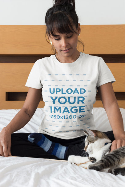 Woman Wearing a T-Shirt Mockup Petting her Cat on Bed a18779