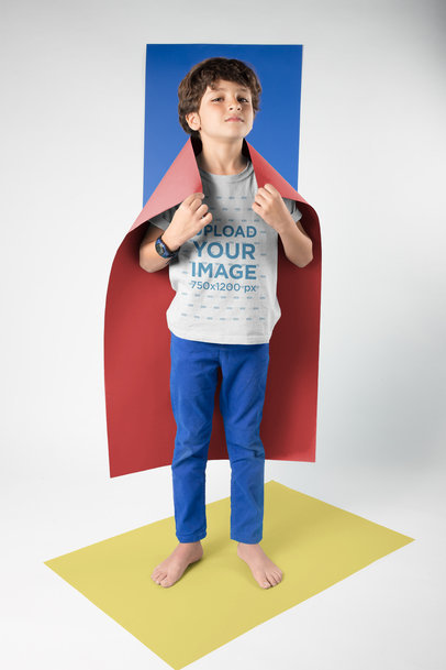 Kid Wearing a T-Shirt Mockup Using a Cape Standing on a Rectangle a19491