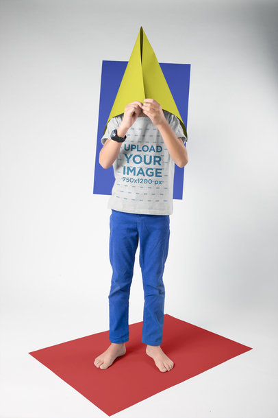 Kid Wearing a T-Shirt Mockup Hiding his Face in a Cone a19489