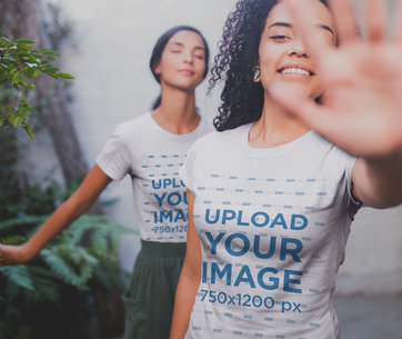 Interracial Girls Wearing Shirts Mockup Blocking the Camera Near Plants a20096