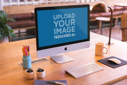iMac Mockup Standing on a Beautiful Wooden Desk a20415