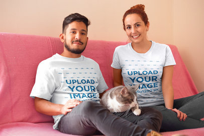 Happy Couple Wearing T-Shirts Mockup with Their Cat a18984